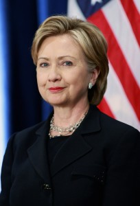 CHICAGO - DECEMBER 01:  Senator Hillary Clinton (D-NY) ;istens as President-elect Barack Obama introduces her as his choice for secretary of state during a press conference at the Hilton Hotel December 01, 2008 in Chicago, Illinois. Other members of the National Security Team named by Obama at the press conference include Washington attorney Eric Holder as attorney general, Arizona Governor Janet Napolitano as his choice for homeland security and he said Robert Gates would remain as defense secretary.  Retired Marine Gen. James L. Jones was selected for the position of national security adviser and Susan Rice as U.N. ambassador.  (Photo by Scott Olson/Getty Images)